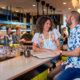 A man and a woman talking at the Suraya Bar in Fishtown